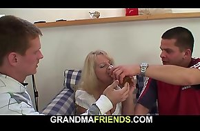 Sloshed blonde grandmother takes two jocks